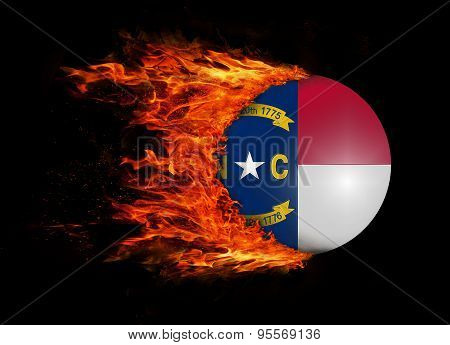Us State Flag With A Trail Of Fire - North Carolina