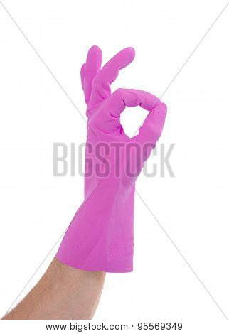 Hand Gesturing With Pink Cleaning Product Glove