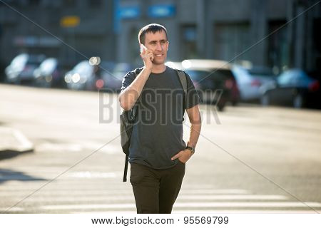 Young Man On Phone On Pedestrian Crosswalk