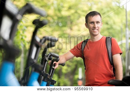 Young Man Renting Bike
