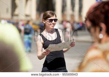 Young Woman With Map On Crowded Square