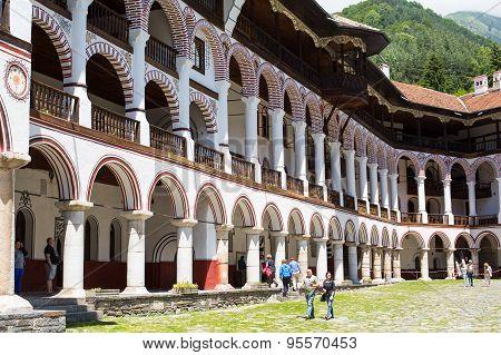Tourists At The Territory Of Famous Rila Monastery, Bulgaria