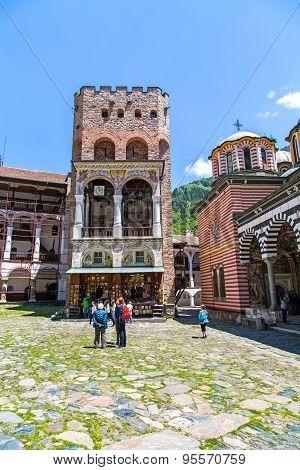 Tourists Near The Icon Shop In Famous Rila Monastery, Bulgaria