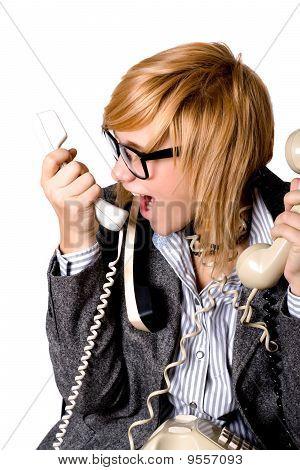 Empresaria con tres teléfonos