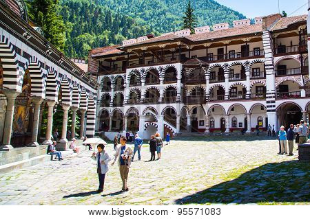 Tourists Near The Church In Famous Rila Monastery, Bulgaria