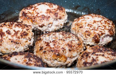 Beef Hamburgers Frying In Pan