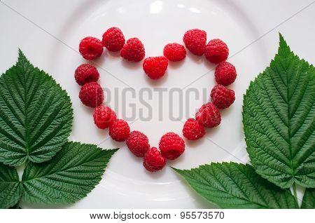 Fresh Raspberry In The Heart Shape