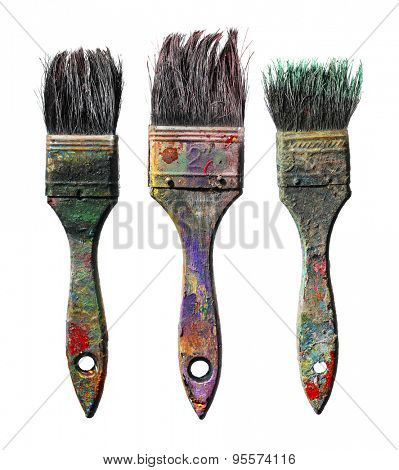 Old dirty paint brushes isolated on white.