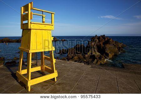Yellow Lifeguard Chair Cabin  In Spain  Lanzarote  Rock Stone Sky Cloud B