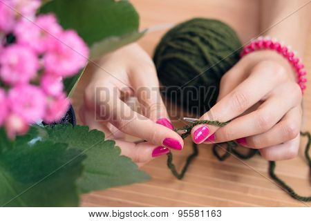 Women's Hands With Pink Manicure Knit Metal Spokes