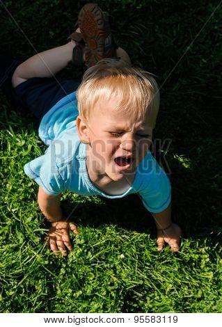 Crying Boy In Garden