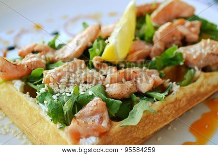 Belgian waffle with arugula, cream sauce and roasted salmon