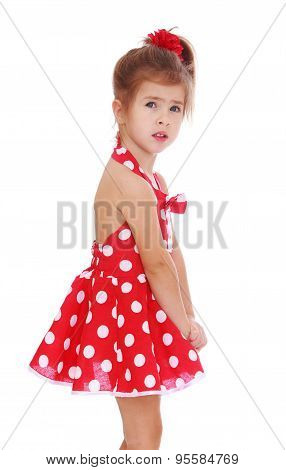 Beautiful little girl in a short red dress