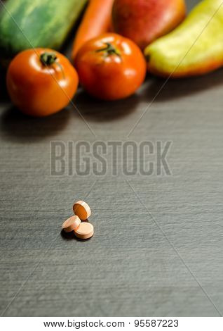 Medicine Tablets With Colorful Vegetables On Background