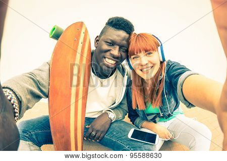 Hipster Multiracial Couple In Love Taking Selfie On White Background - Alternative Fun Concept
