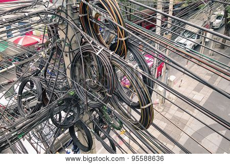 Messy Electrical Cables In Bangkok - Example Of Uncovered Optical Fiber Technology Open Air Outdoors