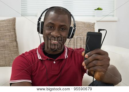 Man Listening Music On Headphones