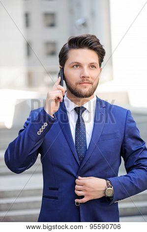 Pleasant man talking on mobile phone