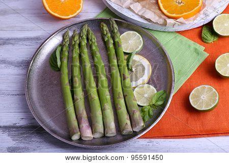 Fresh asparagus on pan, close-up
