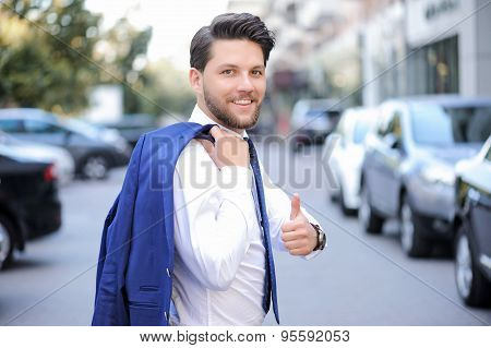 Young pleasant man thumbing up