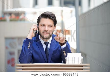 Confident businessman pointing straight