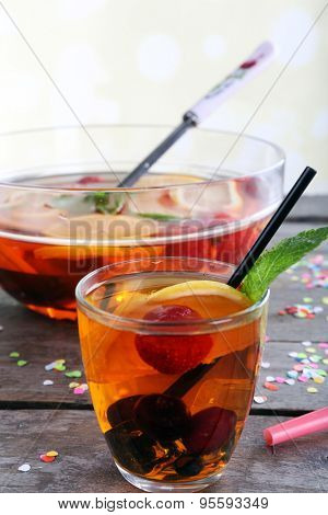 Sangria in bowl and glass on light background