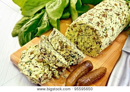 Butter with spinach and greens on light board