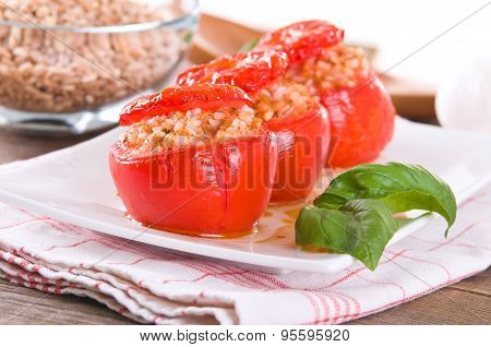 Stuffed tomatoes on a white plate.