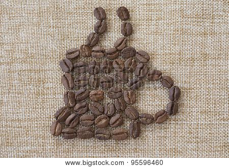 Cup Of Coffee From Coffee Beans Laid Out