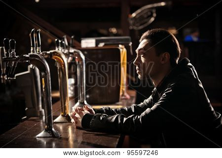 was a hard day. Depressed  man drinking beer in bar