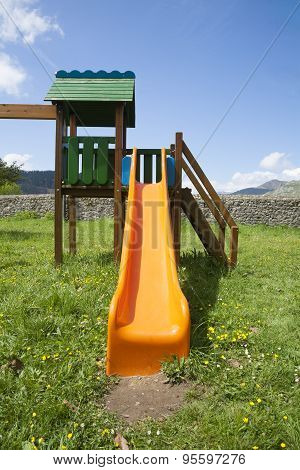 Orange Slide In Grass