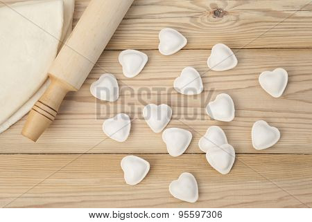 Dumplings In A Heart Shape Dough And Rolling Pin On The Wooden Table.
