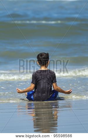 Boy At Peace On The Beach.