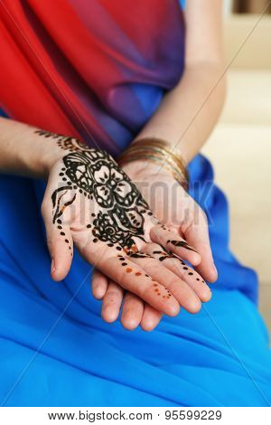 Image of henna on female hands, closeup