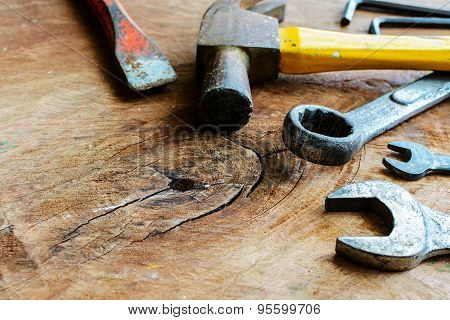 Close Up Of Rusty Hammer And Tools On Old Grunge Wood