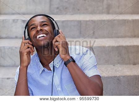 Smiling Young Man Listening To Music On Headphones