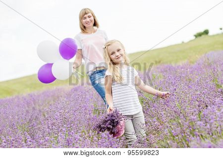 Happy Mother With His Little Daughter