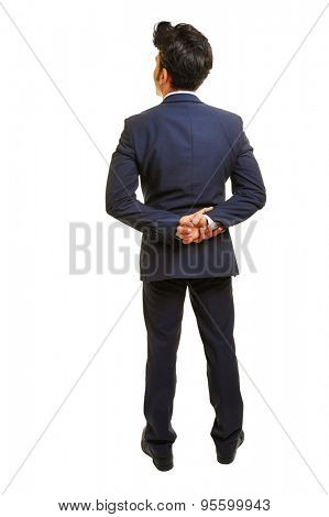 Full body view of business man with his hands behind his back isolated on white