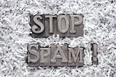 picture of no spamming  - stop spam exclamation made from metallic letterpress type inside of shredded paper heap - JPG