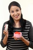 stock photo of salwar-kameez  - Young happy woman opening a gift box - JPG