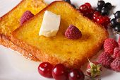 picture of french-toast  - Golden French toast with honey and butter on a plate close - JPG