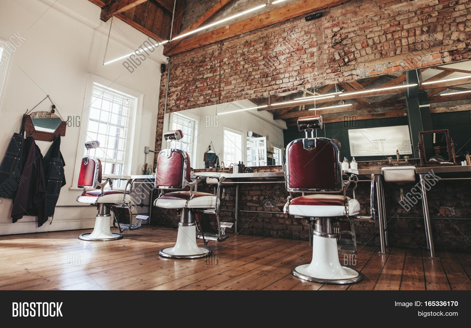 Horizontal shot of empty chairs in retro styled barbershop for 1950 s beauty salon