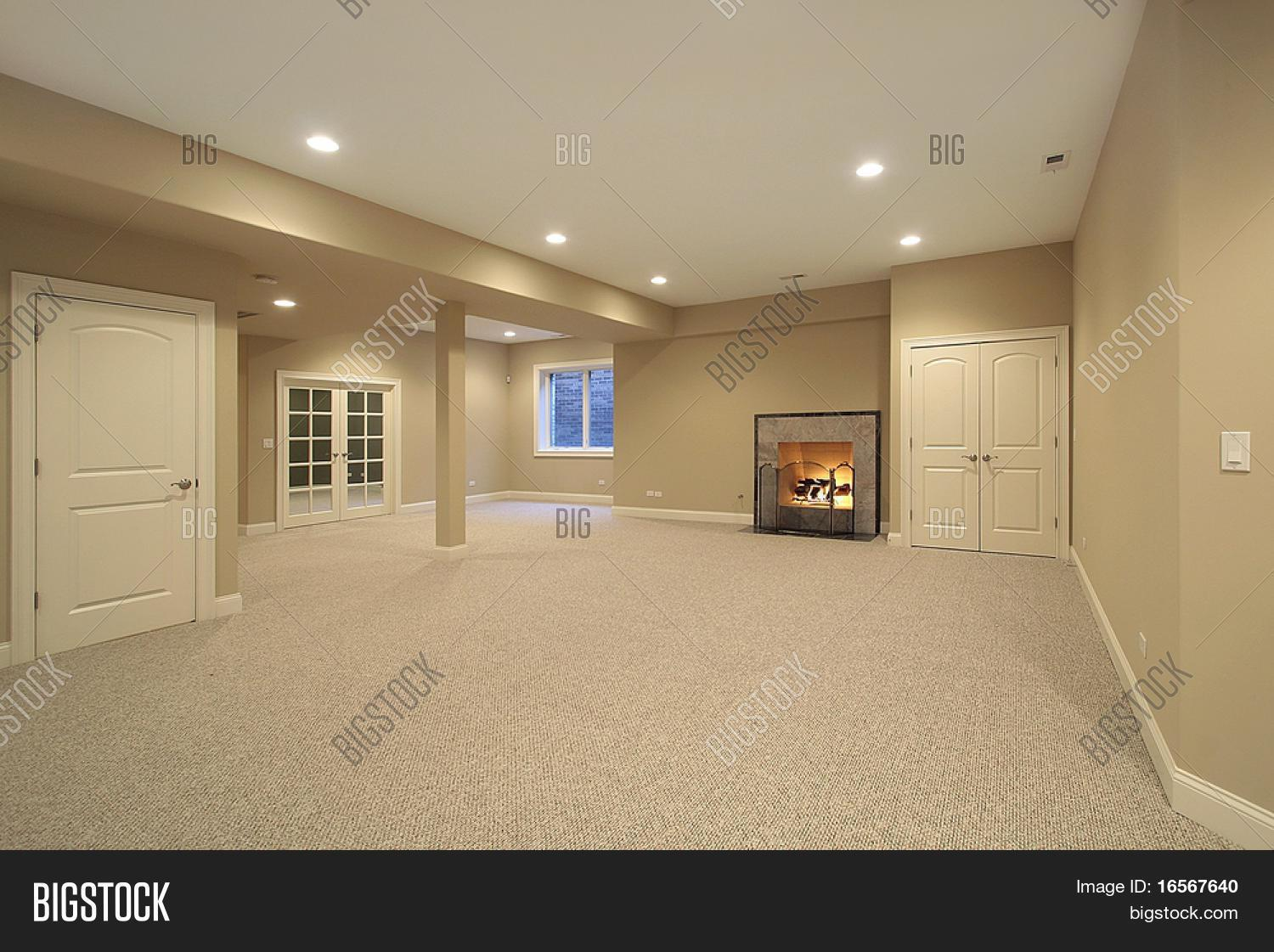 Basement with fireplace in new construction home stock for New construction fireplace