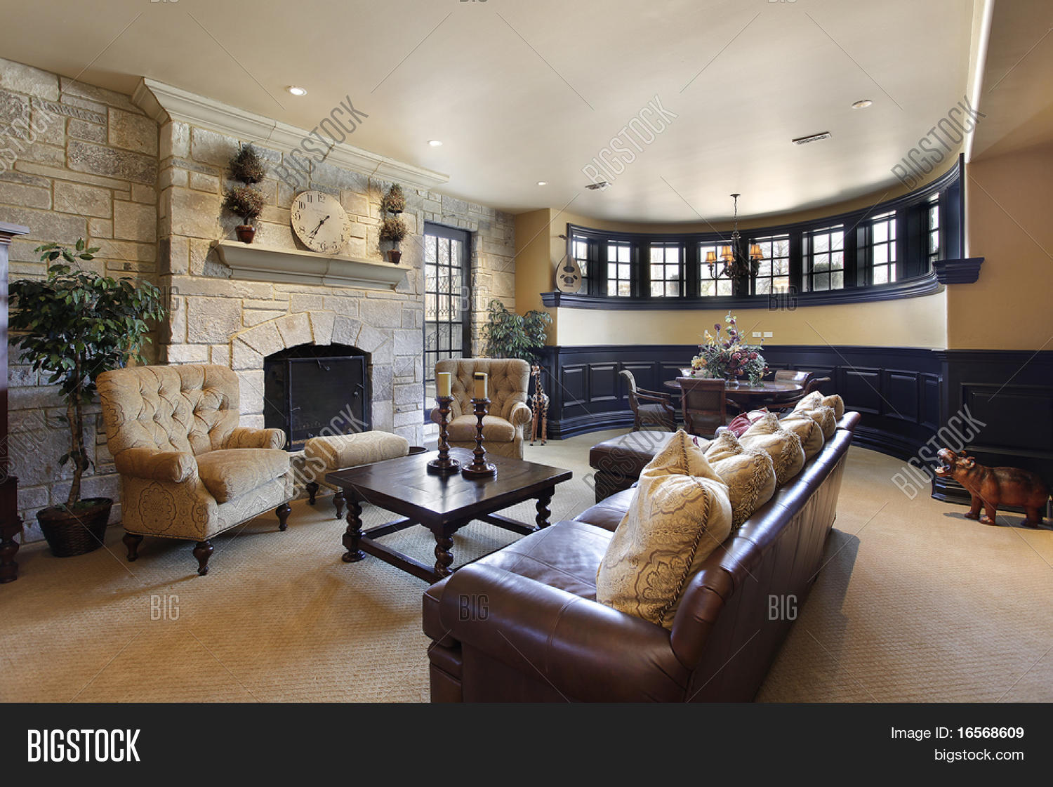 Basement in luxury home with stone fireplace stock photo Luxury fireplaces luxury homes