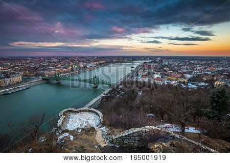 Budapest Hungary - Beautiful sunset over the city of Budapest with River Danube Szabadsag Bridge and Gellert Bath taken from Gellert Hill