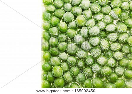Border of fresh frozen green peas with hoarfrost closeup on white background. Isolated. Healthy vitamin food.