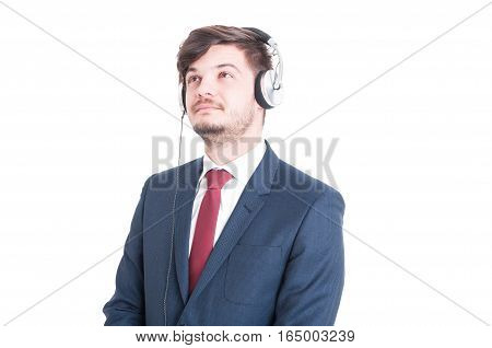 Business Man Looking Up And Listening To Music