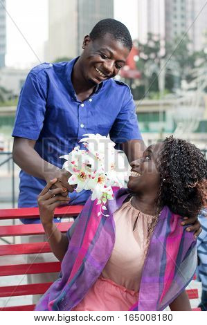 This man made a surprise to his beloved by offering her flowers.