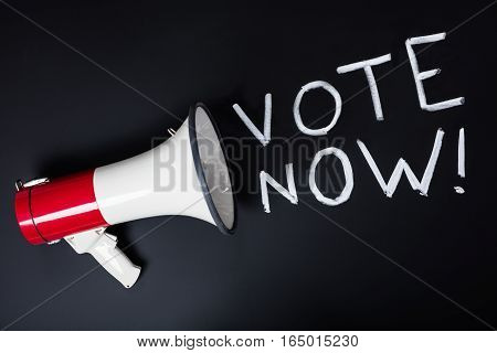Voting Concept With Megaphone On Black Blackboard
