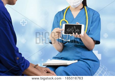 Female Doctor Showing Heart Rate Monitor Application On Mobile To Her Elderly Patient Over Abstract